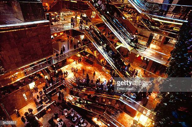 People riding the escalators inside Trump Tower New York City