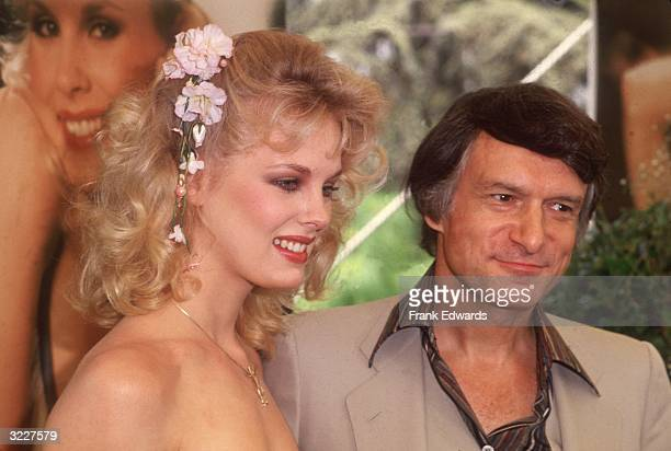 'Playboy' magazine founder and publisher Hugh Hefner with 1980 Playboy Playmate of the Year Canadian model and actor Dorothy Stratten Stratten wears...