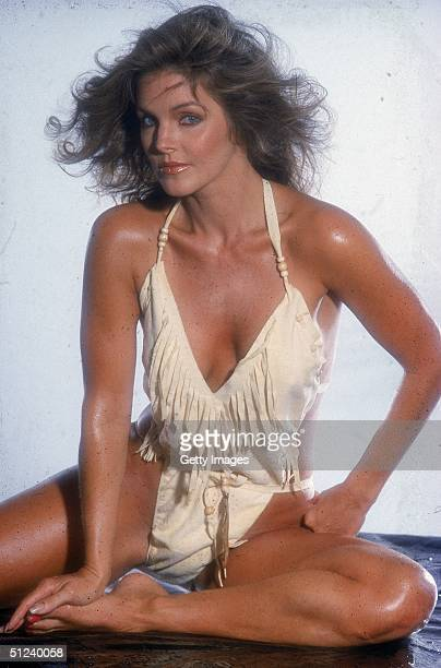 Circa 1980 Studio portrait of American actor Priscilla Presley wearing a fringed suede swimsuit