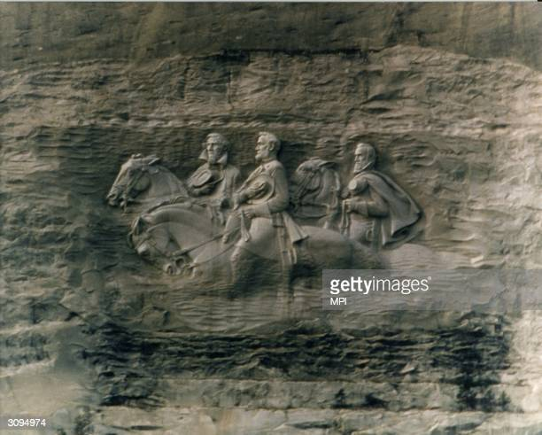 The Confederate Generals carved into Stone Mountain in Stone Mountain National Park Georgia The relief depicts Robert E Lee Stonewall Jackson and...