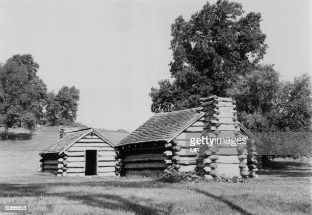 Two of the reconstructed log cabins in Valley Forge National Historical Park Pennsylvania commemorating the winter of 1777 1778 when George...
