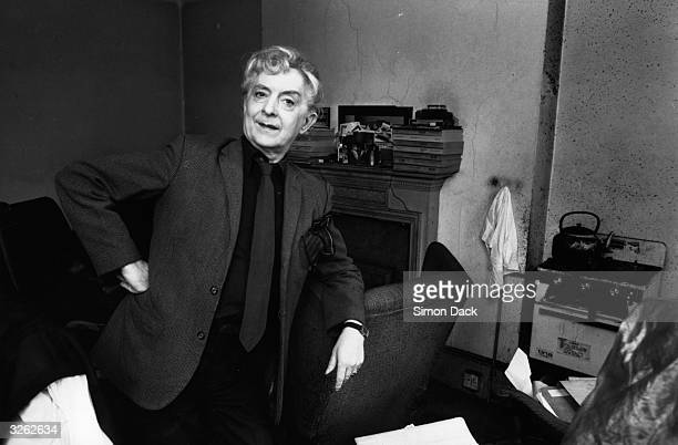 British writer Quentin Crisp relaxes in his Chelsea home.