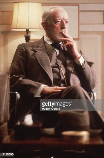 Actor Alec Guinness in a thoughtful mood