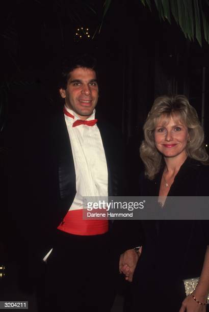American actor and body builder Lou Ferrigno and his wife Carla smile while attending a formal event Ferrigno is wearing a tuxedo with a red...