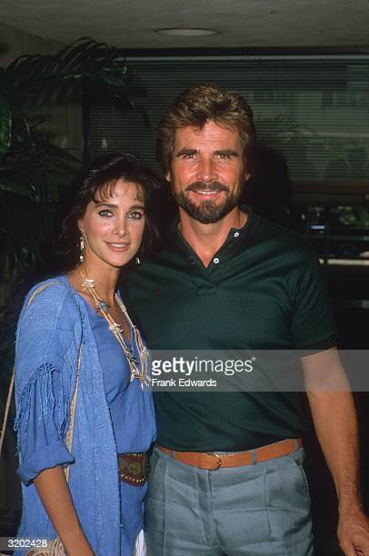 American actors Connie Sellecca and James Brolin smile with their arms around each other