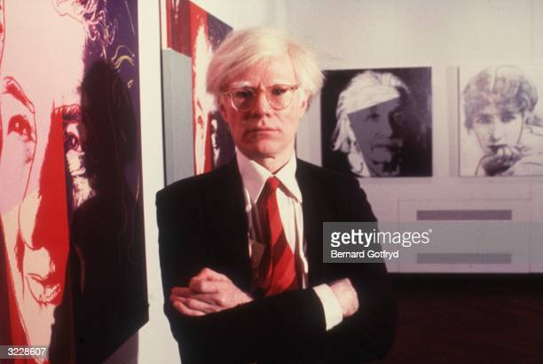 American pop artist Andy Warhol poses at an exhibition of his lithographs at the Jewish Museum New York City Portraits of Golda Meir and Albert...