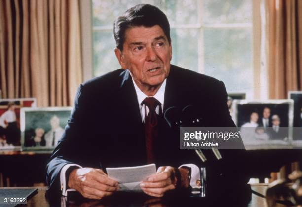 American president Ronald Reagan makes an announcement from his desk at the White House, Washington DC.