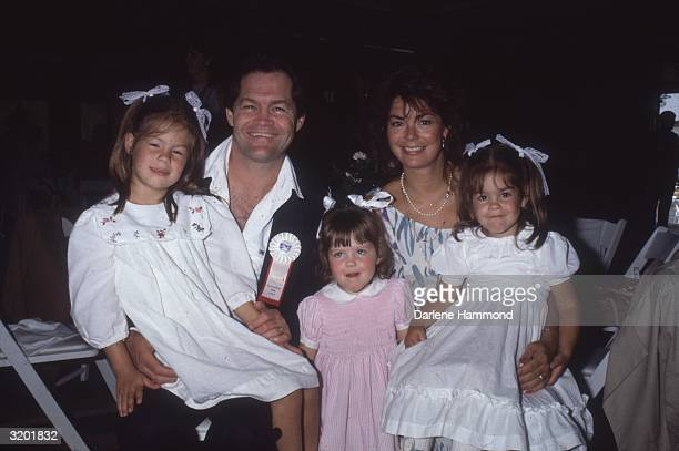 American rock musician and actor Micky Dolenz and his second wife Trina pose with their daughters Charlotte Georgia and Emily 1980s Dolenz was a...