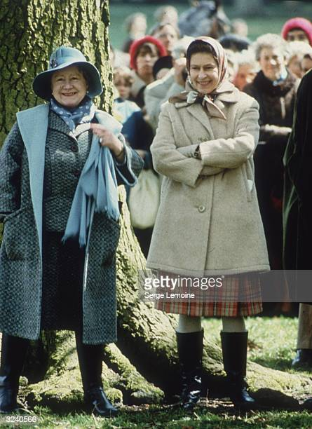 Queen Elizabeth II and Elizabeth the Queen Mother looking relaxed in warm outdoor clothes while watching the Badminton Horse Trials