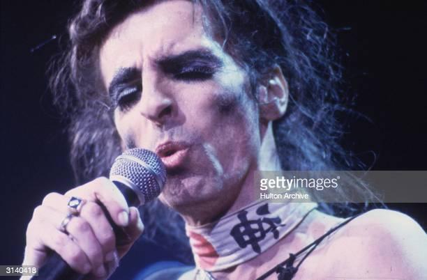 Shock rock singer Alice Cooper performing on stage