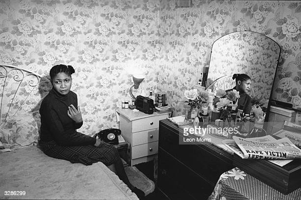 A West Indian woman in her bedroom
