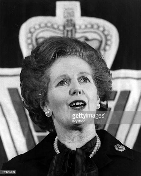 British Conservative Prime Minister Margaret Thatcher makes a speech in front of a crown logo