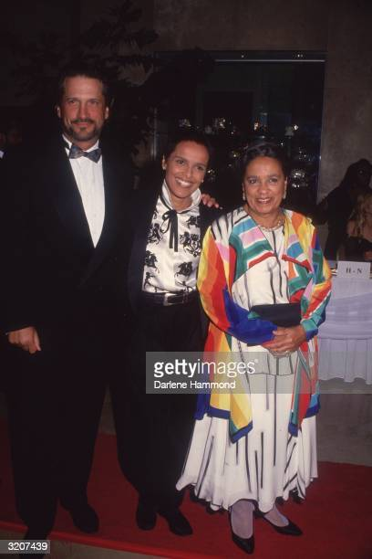 Left to right fulllength portrait of actors and married couple Sam Behrens and Shari BelafonteHarper standing with her mother Marguerite Byrd at a...