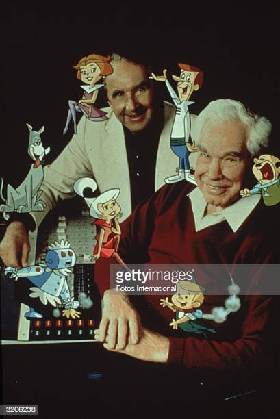 Studio portrait of American animators Joseph Barbera and William Hanna posing with members of the cartoon family 'The Jetsons'