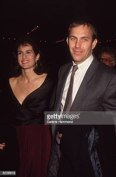 American actor Kevin Costner and his wife Cindy Silva smile while arriving at a semiformal event