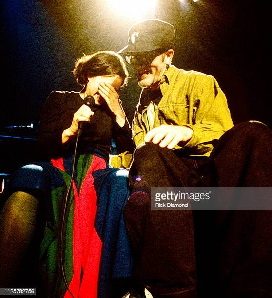 REM's Michael Stipe joins Natalie Merchant of 10000 Maniacs on stage at The Fox Theater in Atlanta Georgia circa 1992