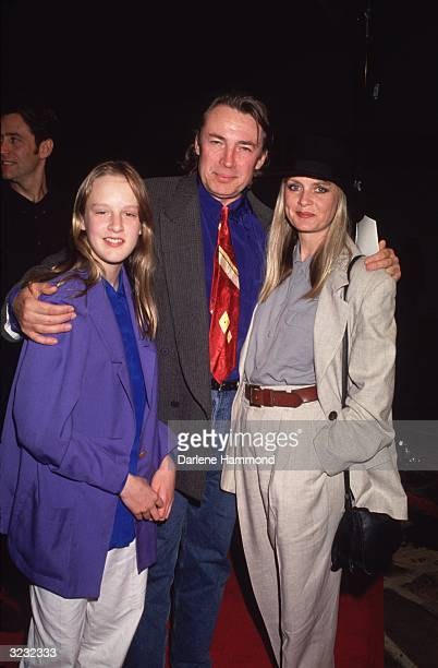 A portrait of British actorturnedmodel Twiggy Lawson standing with her hands in her pockets while her husband Leigh Lawson puts his arm her and her...