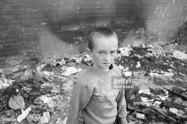 A young boy in the Falls Road area of Belfast Northern Ireland