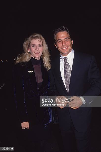American actor Tony Danza and his wife Tracy Robinson attending an unidentified formal event Danza wears a tuxedo Robinson wears a navy velvet suit
