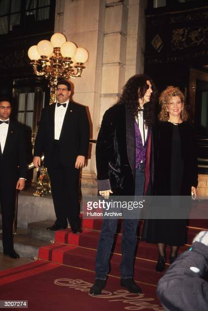 American radio host Howard Stern standing with his wife Alison outside the main entrance to the Plaza Hotel New York City