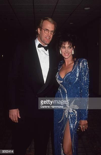 American television personality and musician John Tesh and his wife American actor Connie Sellecca attend a formal event Sellecca is wearing a blue...