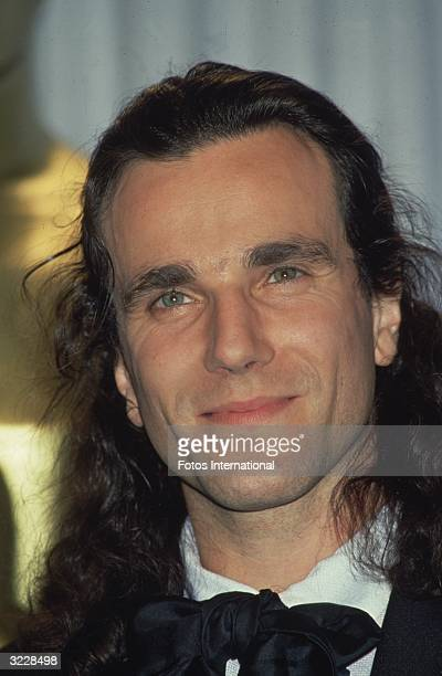 Closeup of British actor Daniel DayLewis smiling in a tuxedo at the Academy Awards Los Angeles California