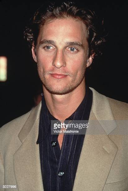 Headshot of American actor Matthew McConaughey in a camel hair blazer and black shirt New York City