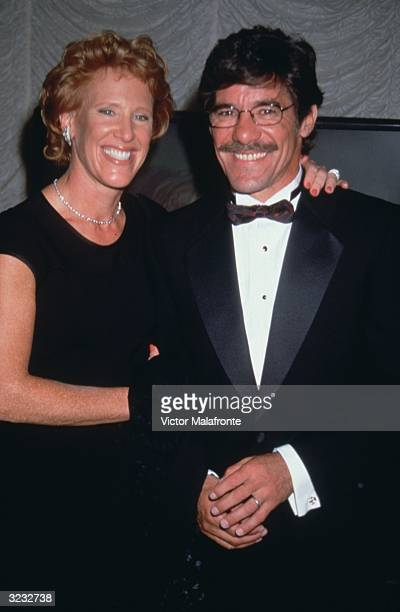American talk show host Geraldo Rivera standing with his wife C C Dyer at an unidentified formal event