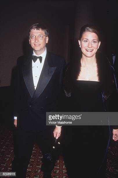 Microsoft CEO Bill Gates and his wife Melinda stand together wearing formal attire New York City
