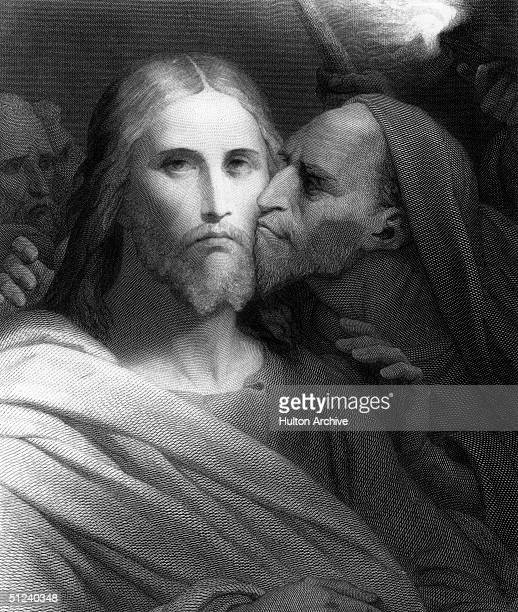 Circa 30 AD Jesus Christ being kissed by Judas Iscariot the apostle who betrayed him