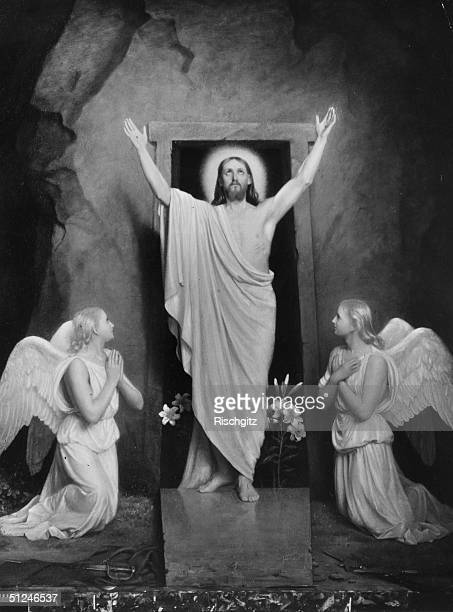 Circa 33 AD Angels kneeling on either side of Jesus Christ as he lifts his arms to heaven before his resurrection