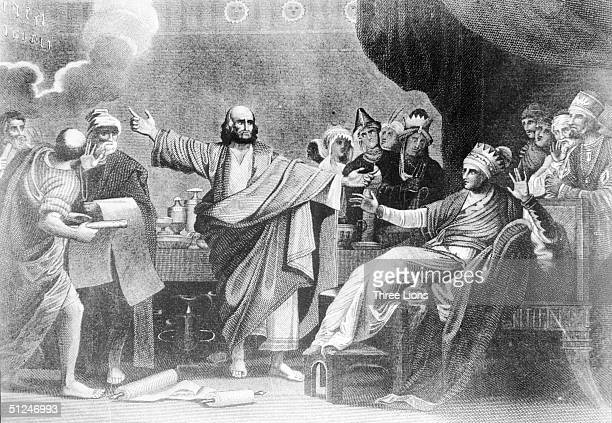 Circa 540 BC The moment at the feast of Belshazzar left according to the Old Testament the last Chaldean king of Babylon when a hand appeared before...