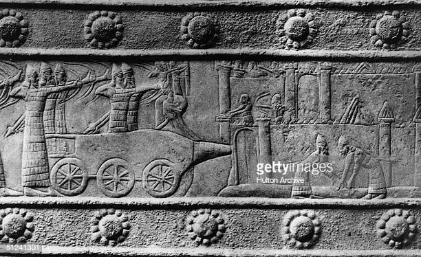 Circa 700 BC Soldiers of the Assyrian army besieging a city using a battering ram on a wallcarving Mesopotamia