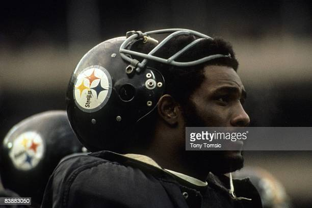 Defensive lineman Joe Green of the Pittsburgh Steelers watches the action from the sidelines during a game in the early1970s