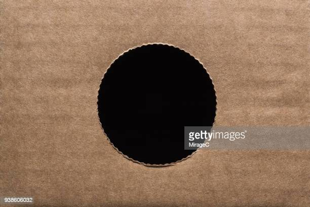 circle hole in cardboard paper - hole stock pictures, royalty-free photos & images