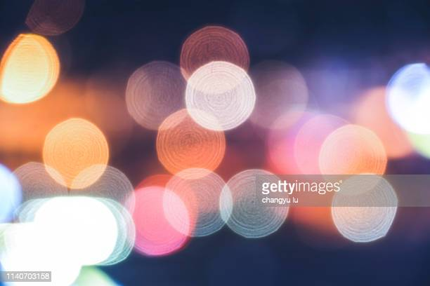 circle light;defocused image of illuminated city - デフォーカス ストックフォトと画像