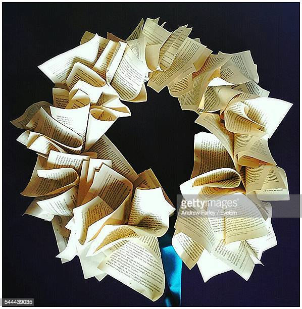 Circle Made From Folded Papers Against Black Background