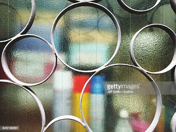 Circle Metal Grate Against Frosted Glass Window