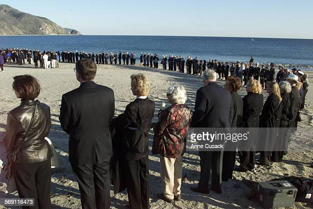 Circle of Caregivers surround family members and friends of Alaska Airlines Flight 261 crash victims during the Memorial Service on the beach at...