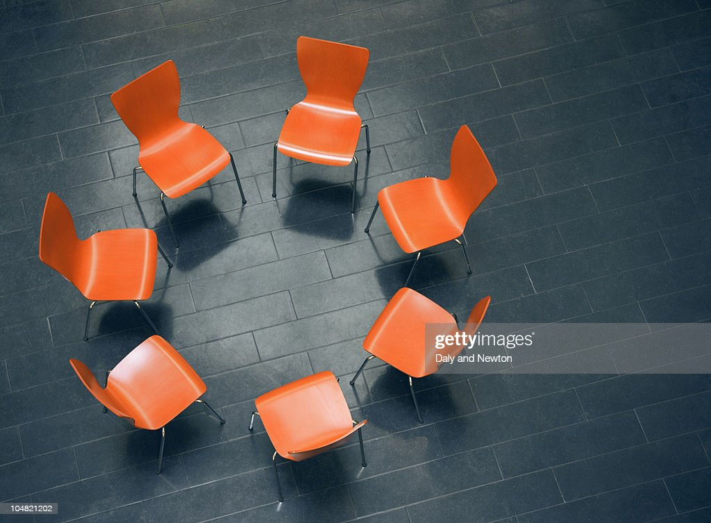Circle of empty chairs : Stock Photo