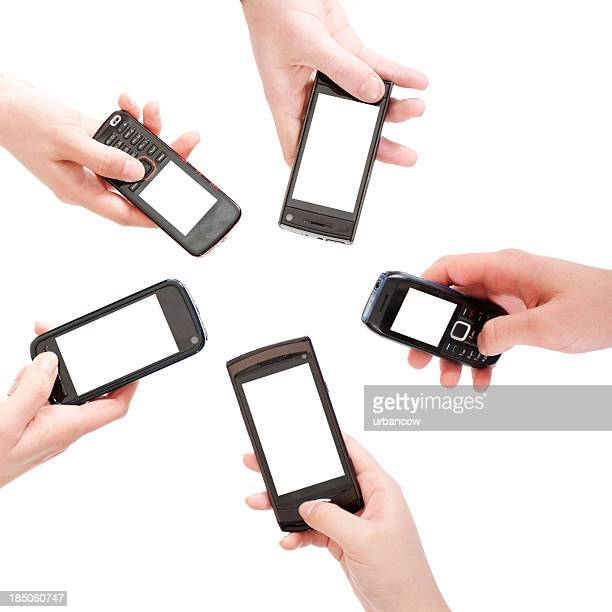 Circle of hands with cell phones