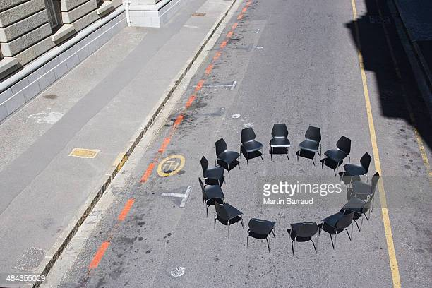 Circle of office chairs in roadway