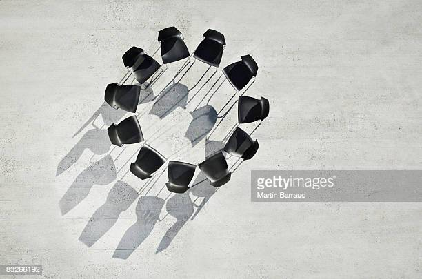 circle of office chairs on sidewalk - group of objects stock photos and pictures