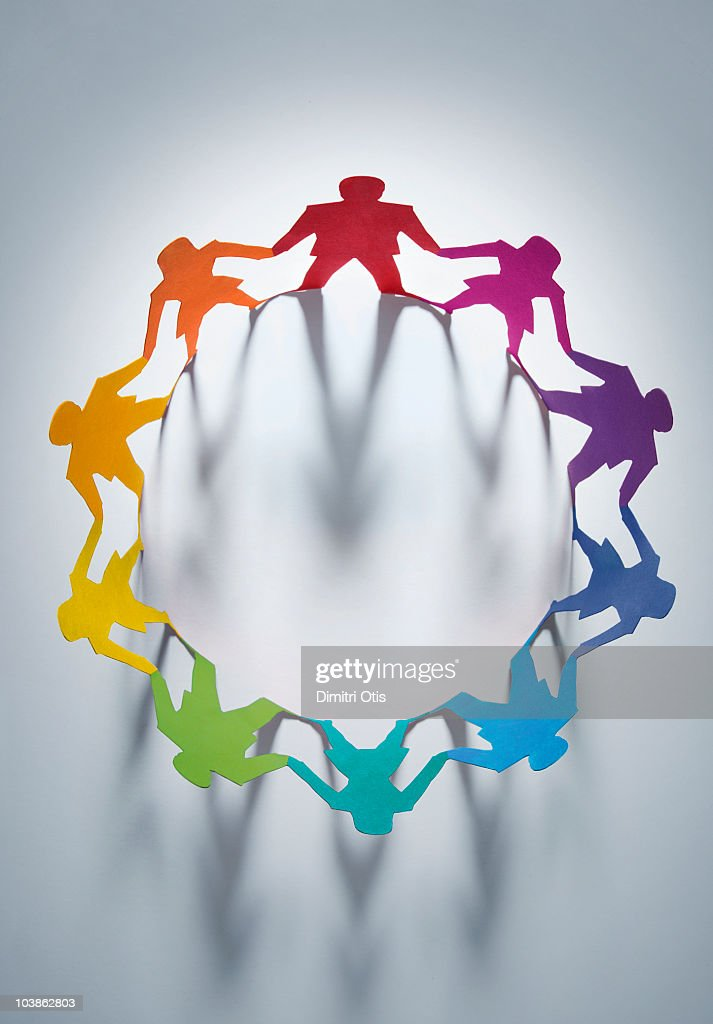 Circle of rainbow colored cutout paper figures : Stock Photo