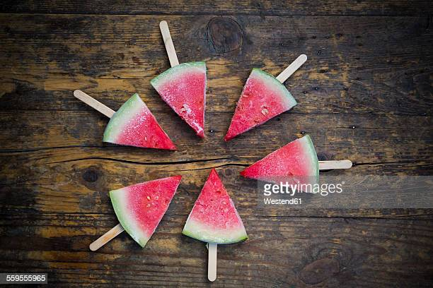 Circle of six watermelon popsicles