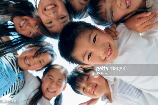 circle of young friends - childhood stock pictures, royalty-free photos & images