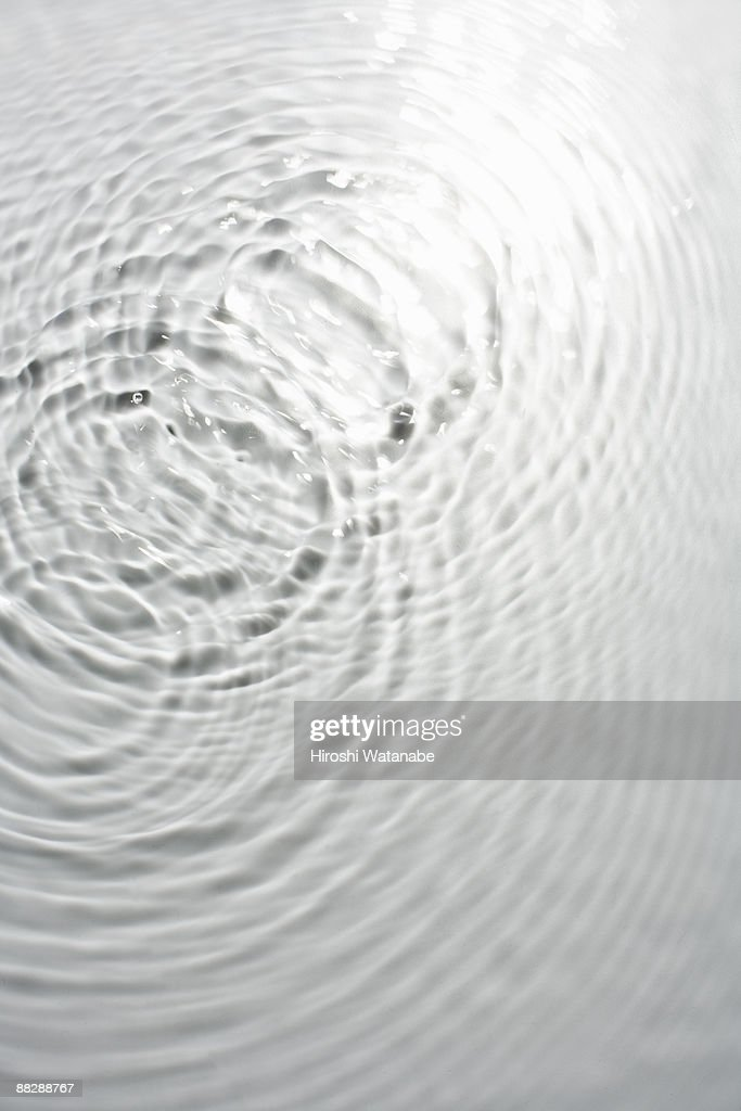 Circle ripples on water surface : Stock Photo