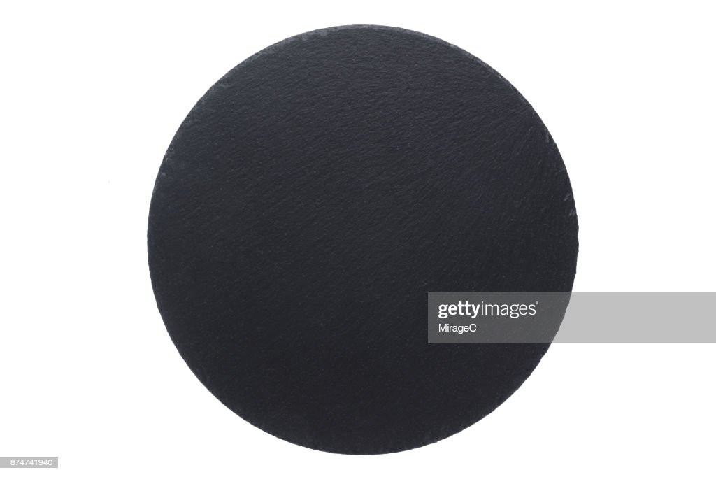 circle shape black stone plate on white stock photo getty images