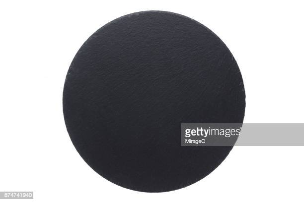 circle shape black stone plate on white - slate rock stock photos and pictures
