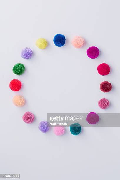 circle which i made with colorful pompon. - pom pom stock pictures, royalty-free photos & images